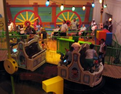 Loading dock and vehicles for those requiring special assistance at Toy Story Midway Mania
