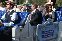 Soon after the confetti settled, Quinn and Danielle joined Mickey Mouse for a cavalcade down Main Street, U.S.A., led by the Disneyland Band.