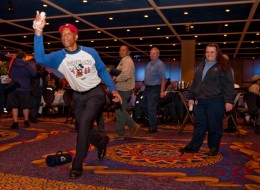 Disneyland Resort President Ed Grier and Cast Member Genie Levert play a game of Nintendo Wii Bowling during a breakfast in honor of third shift Cast Members. (<i>Courtesy Disneyland</i>)