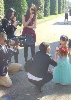 "Each princess was paired with a ""Little Princess"" for the day. The lucky girl picked to be with Ariel being interviewed about the experience."