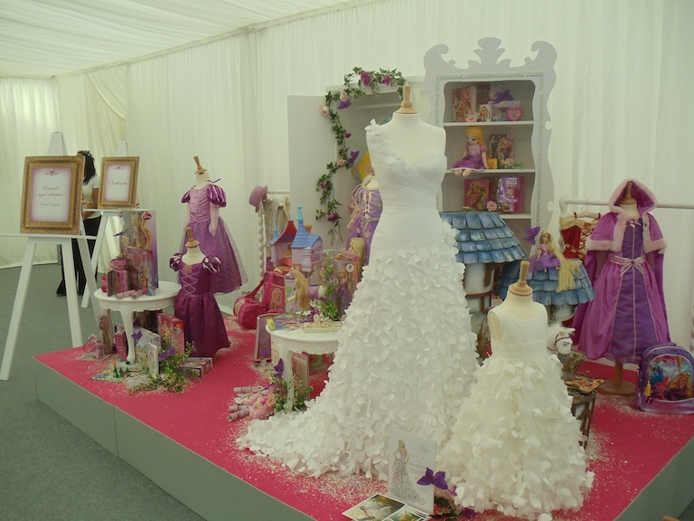 The display of Tangled merchandise, including the Disney Fairytale Wedding dress inspired by the movie (designed by Alfred Angelo)