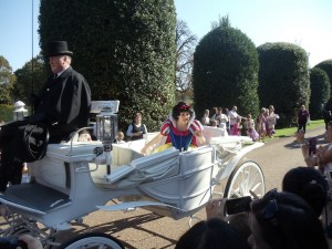Snow White leads the procession through the Kensington Palace gardens