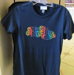 "New rainbow ""Magic Kingdom"" t-shirt with rhinestones. Shirt is a nice quality too."