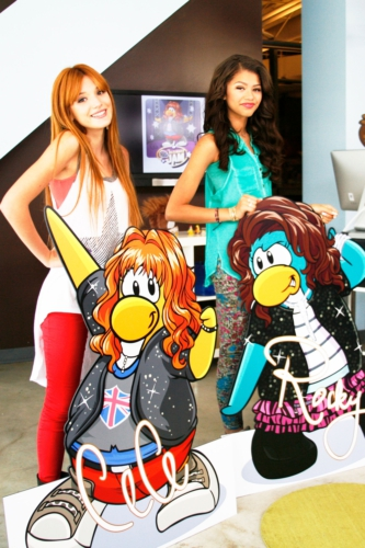 "Bella Thorne and Zendaya from Disney Channel's ""Shake It Up"" pose with their CeCe and Rocky penguins"