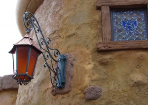 Beautiful lamp with a nice orange glow at night and a stained glass window with the letter G... I wonder who that is for