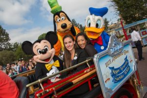 The 2013-2014 Disneyland Resort Ambassador Team, Megan Navarette (left) and Sachiko White (right), travel down Main St. U.S.A. with Disney characters following the ceremony.