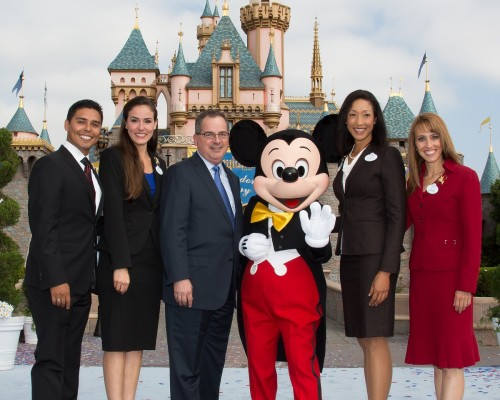 Disneyland President George Kalogridis with current and former ambassadors, plus Mickey Mouse