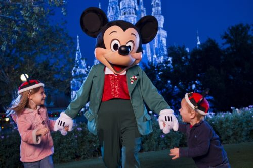 Mickey Mouse at hte Magic Kingdom in his xmas finest