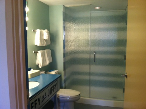 Art of Animation Suite's feature a master bath with a walk-in shower.