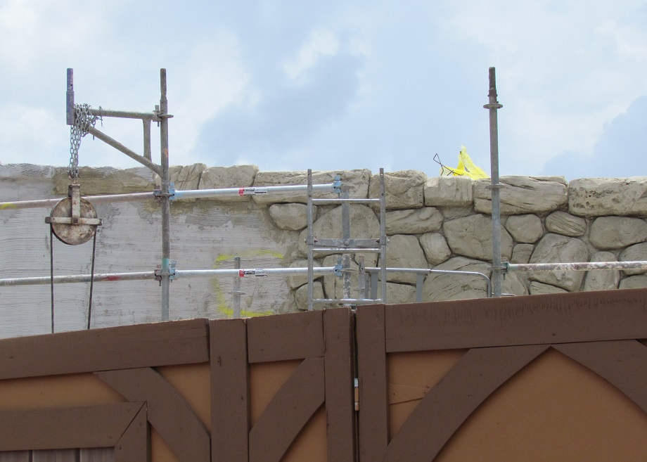 Including themeing the wall that will separate the track from guest walkway