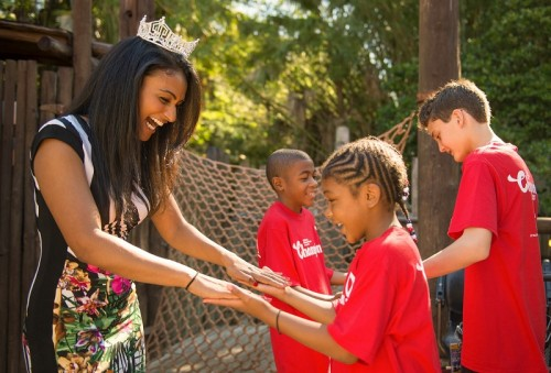 "Miss America 2014 Nina Davuluri of Syracuse, NY, joins members of the 2013 ""Champions of Children's Miracle Network (CMN) Hospitals"" at Walt Disney World"