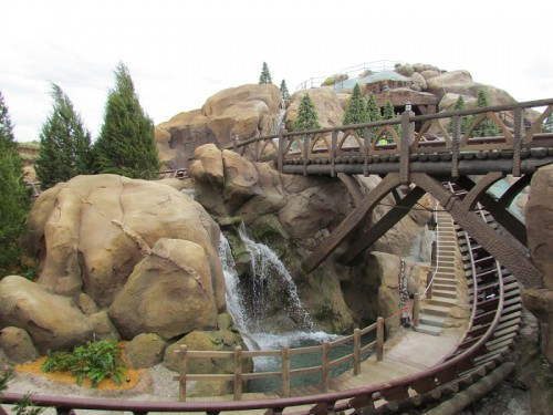 A large sweeping drop will send passengers on the Seven Dwarfs Mine Train speeding past a waterfall and over a wooden bridge.
