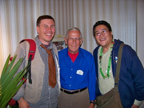 Imagineer Bob Gurr flanked by two fans.