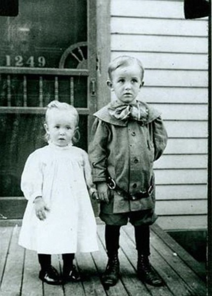 Walt and his sister Ruth on the porch of their Chicago birthplace