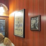 A vintage photo and humorous poster adorn other wall