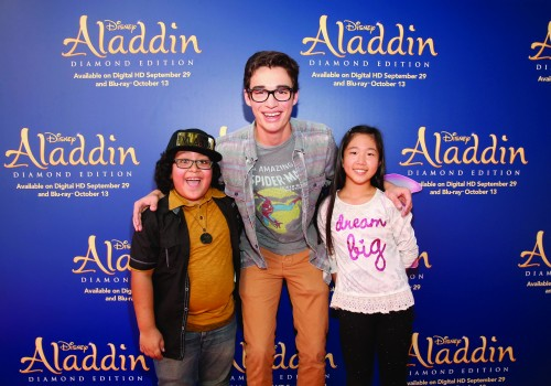 "BURBANK, CA - SEPTEMBER 27: (L-R) Actors Nathan Arenas, Joey Bragg and Nina Lu attend a special LA screening celebrating Diamond Edition release of ""ALADDIN"" at The Walt Disney Studios on September 27, 2015 in Burbank, California. (Photo by Jesse Grant/Getty Images for Disney)"