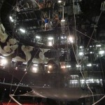 Trapeze artists practice before the first show if the evening