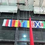 National flags of the show's performers, plus practice trapeze rig