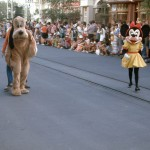 What is Goofy doing behind Pluto?