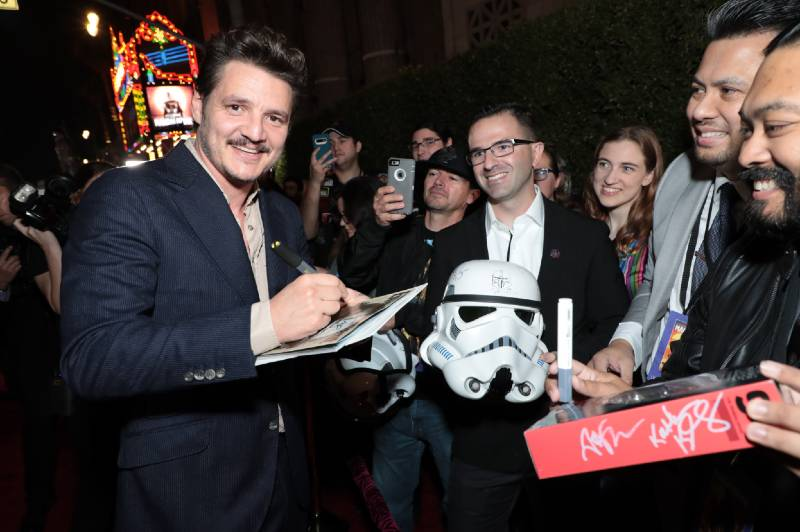 "Pedro Pascal signs autographs for fans at the premiere of Lucasfilm's first-ever, live-action series, ""The Mandalorian"", at the El Capitan Theatre in Hollywood, CA on November 13, 2019. ""The Mandalorian"" streams exclusively on Disney+.(photo: Alex J. Berliner/ABImages)"