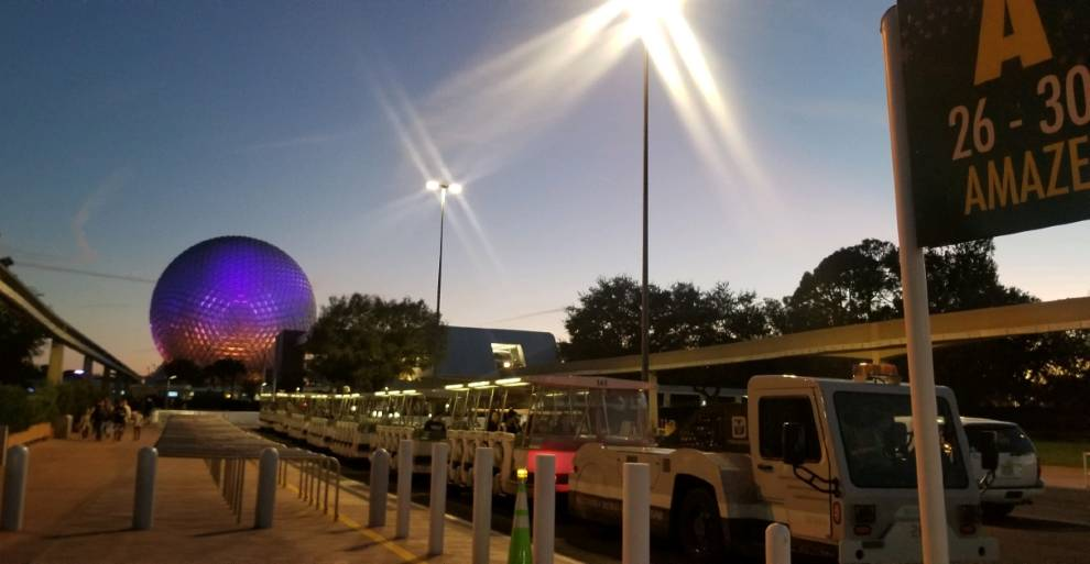 EPCOT tram loading zone with Spaceship Earth in the background.