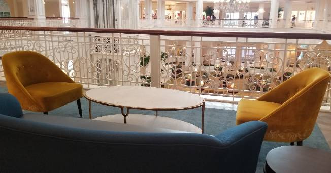 Seating in the beauty and the beast lounge at the Grand Floridian