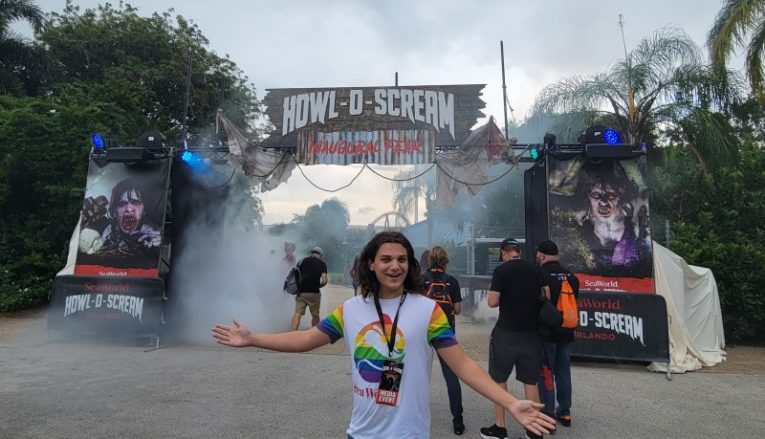 Indigo is ready to enter Howl-o-Scream at SeaWorld, Orlando. A marquee with plenty of fog is in the background