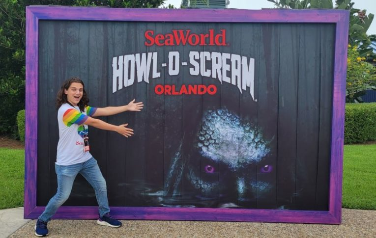Indigo gets excited about Howl-o-Scream at SeaWorld, Orlando in front of a photo backdrop
