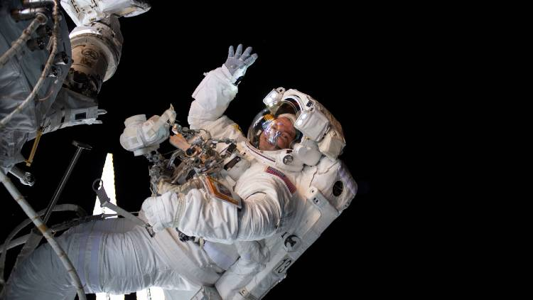 Disney+ - Among the Stars - NASA astronaut Andrew Morgan waves while on a space walk.